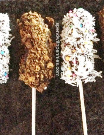 banana pops, 2 covered with coconut and 2 covered with nuts