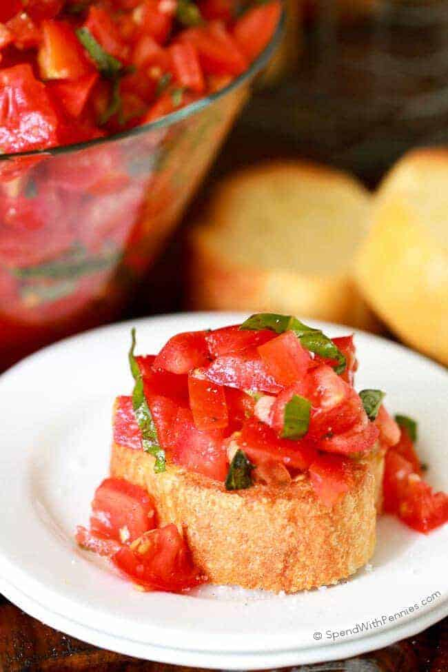 While we usually think of bruschetta as the tomato portion of this recipe, the word bruschetta actually refers to preparation of the bread (cut, olive oil and garlic'd). It isn't always topped with tomatoes, it can be made with other ingredients too (like mushrooms or cheeses), but this tomato concoction is my favorite!