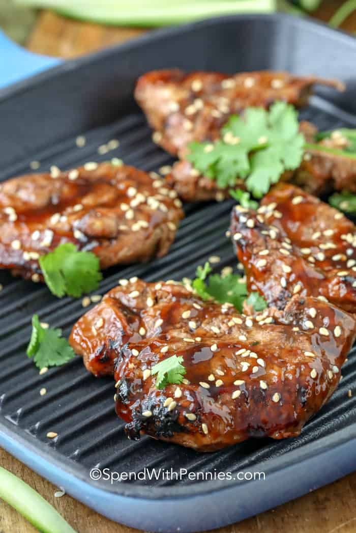 Pork Teriyaki with sesame seeds on a grill pan