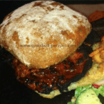 Barbecued Teriyaki Pork Tenderloin Sandwich on a bun with salad