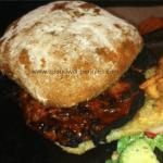 Barbecued Teriyaki Pork Tenderloin Sandwich on a bun with salad