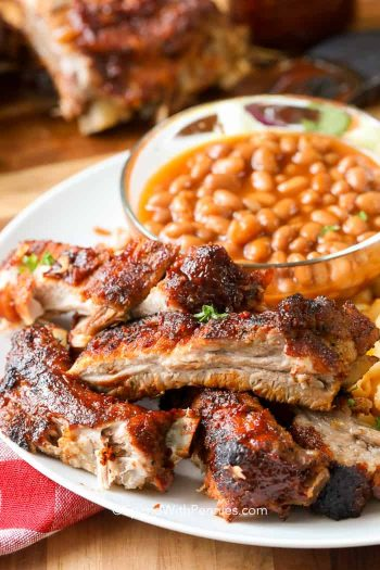 Barbecue Ribs served on a plate with baked beans