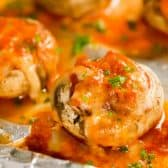 Easy Stuffed Mushrooms on foil with parsley