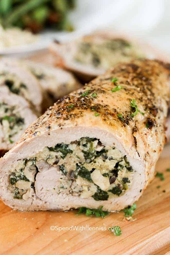 Stuffed Pork Tenderloin filled with a flavorful spinach and mushroom stuffing and roasted to perfection. This easy meal is perfect for any day of the week!