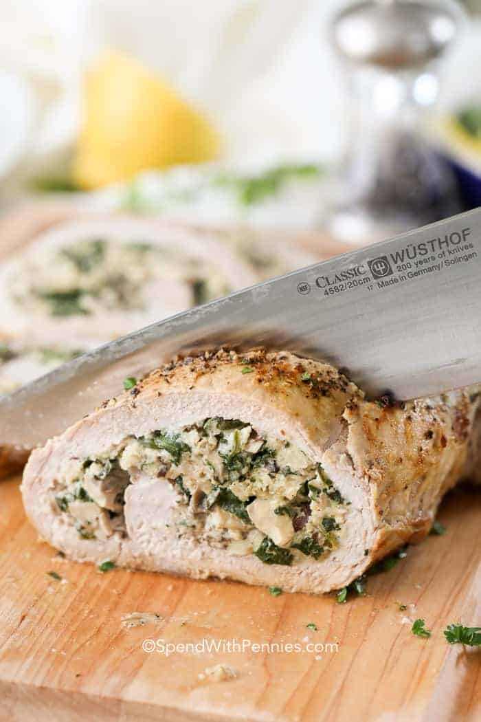 Pork tenderloin filled with a delicious mushroom and spinach filling is the perfect meal. Remember to let it rest before slicing!
