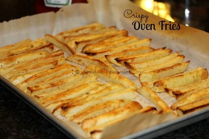 crispy oven fries on parchment paper