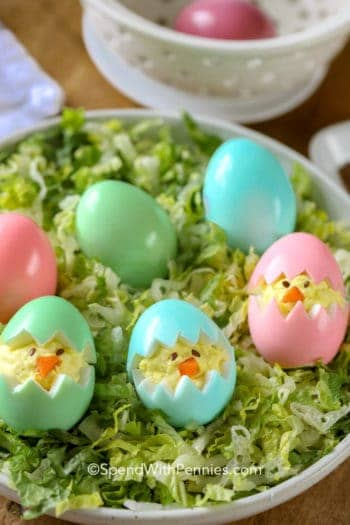 Deviled Egg Chicks in a bowl on top of lettuce