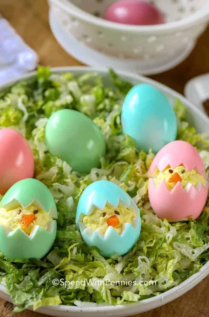 Deviled egg chicks arranged on fresh lettuce to resemble grass.