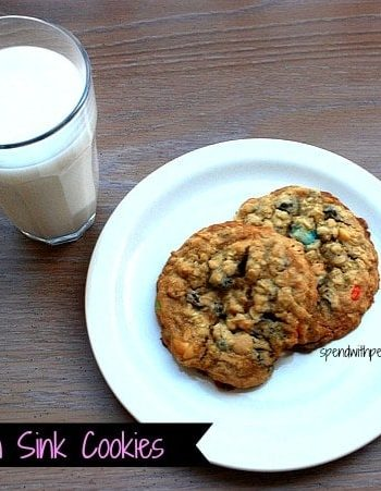kitchen sink cookies on white plate with glass of milk