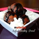 nutella stuffed monkey bread with whipped cream on a white plate
