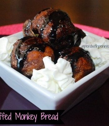nutella stuffed monkey bread with sauce and dipping cream in a white dish