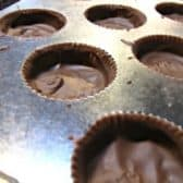 chocolate in the bottom of a muffin wrapper for homemade Reeses Peanut butter cups