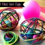 treat filled yarn eggs on a plate
