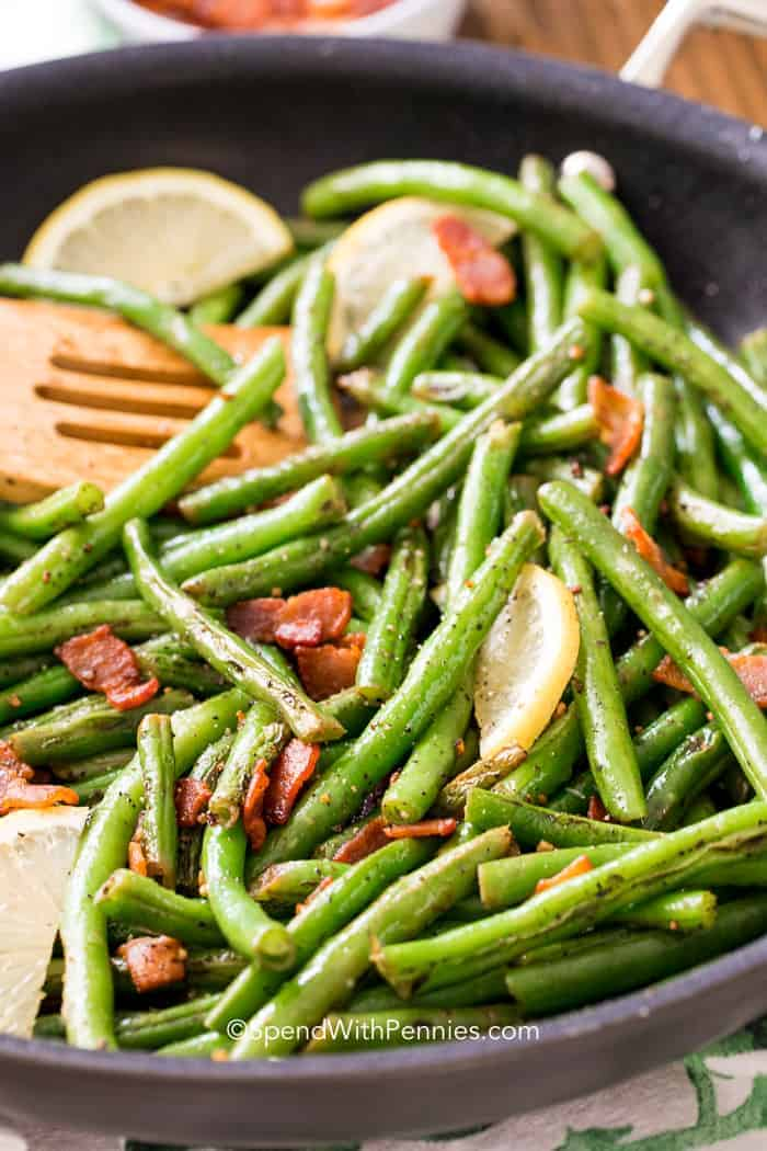 The perfect side for any chicken or steak dish! Tender crisp green beans with bacon is one of our all time favorite side dishes! Fresh green beans, bacon and garlic with a squeeze of fresh lemon!