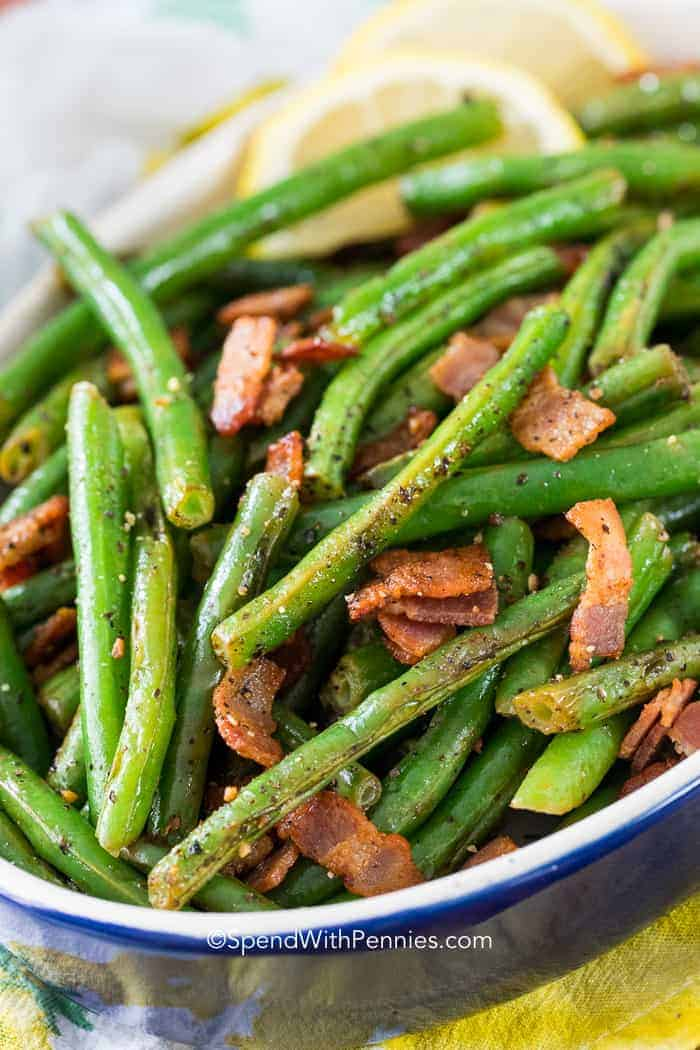 Tender crisp green beans with bacon is one of our all time favorite side dishes! Fresh green beans, bacon and garlic with a squeeze of fresh lemon!