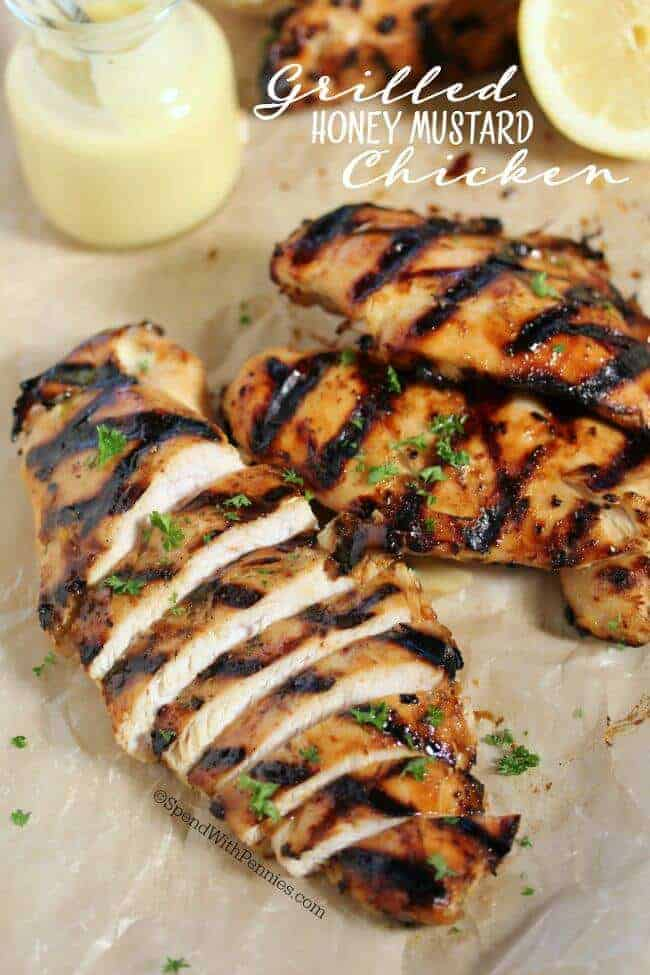 Grilled honey mustard chicken sliced with lemons