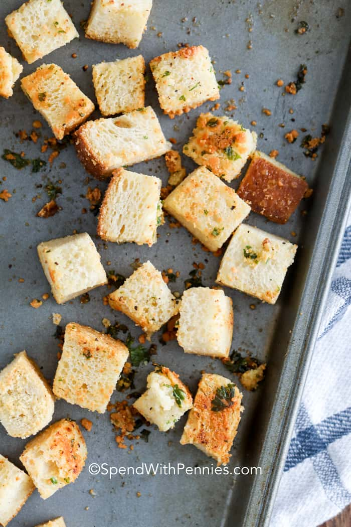 A baking sheet with homemade croutons on it fresh from the oven.