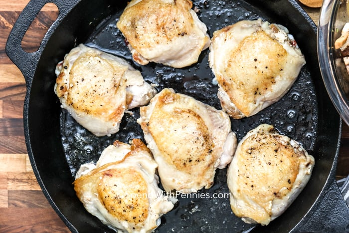 Overhead shot of chicken being cooked in a pan