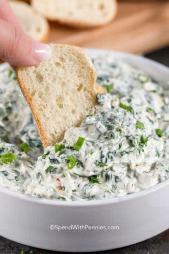 Spinach Dip being dipped with bread