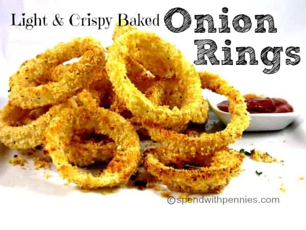 pile of panko baked onion rings with ketchup in dipping bowl