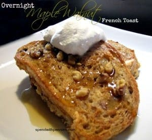 overnight maple walnut French toast with syrup and whipped topping on a white plate