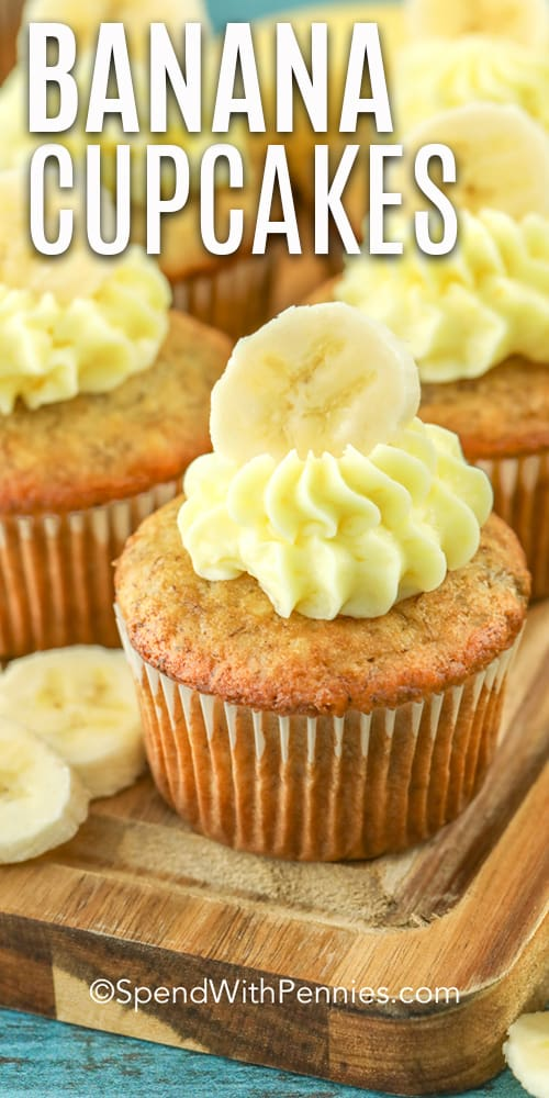 Banana cupcakes frosted with a sliced banana on top.