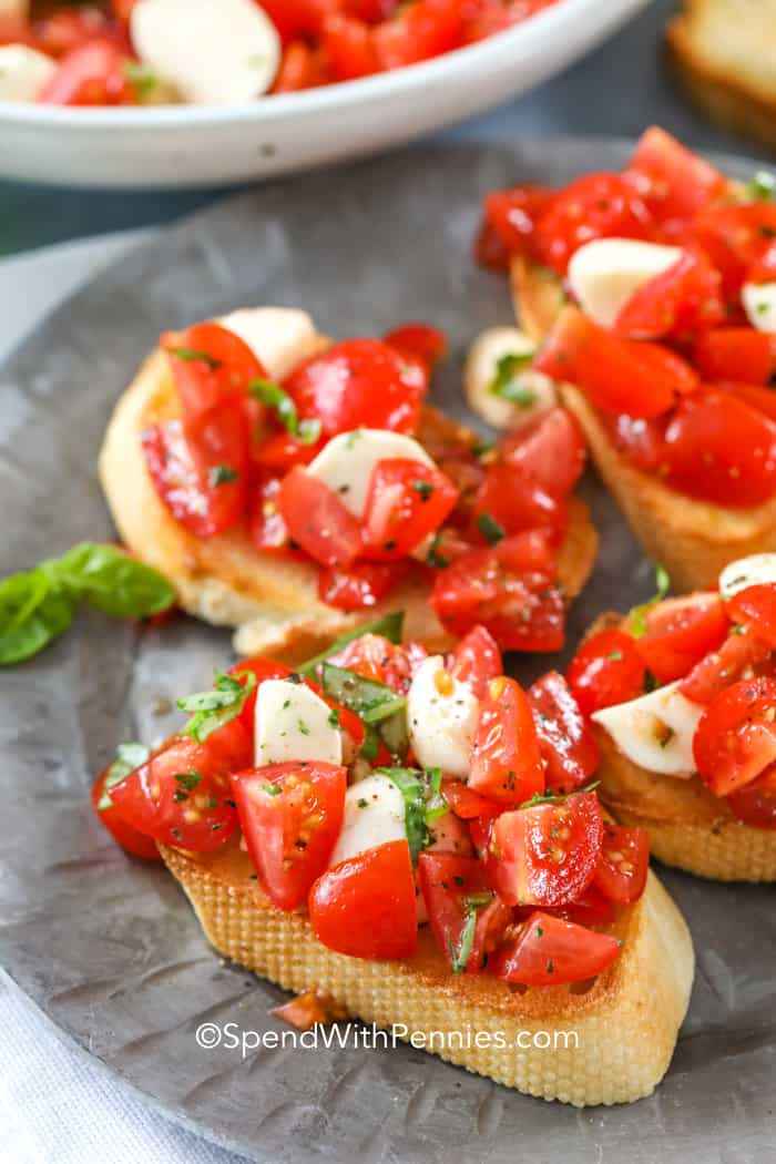Caprese bruschetta spread on a crostini.