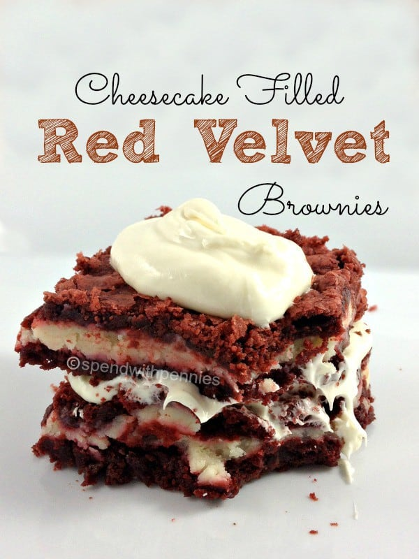 cheesecake filled red velvet brownies stacked, with topping