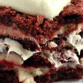 closeup of cheesecake stuffed red velvet brownies