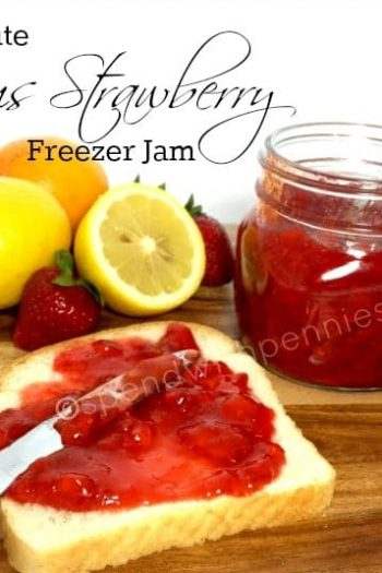 strawberry freezer jam in a jar with jam on a slice of bread and some fruit in the background