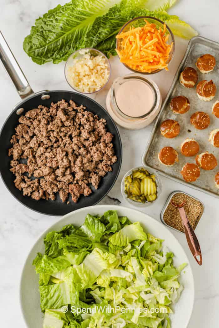 all the ingredients in bowls and a pan to make a Big Mac Salad