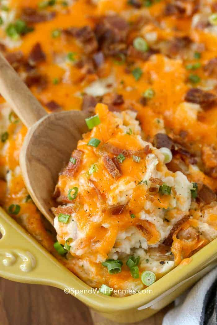 Twice Baked Potato Casserole with wooden spoon
