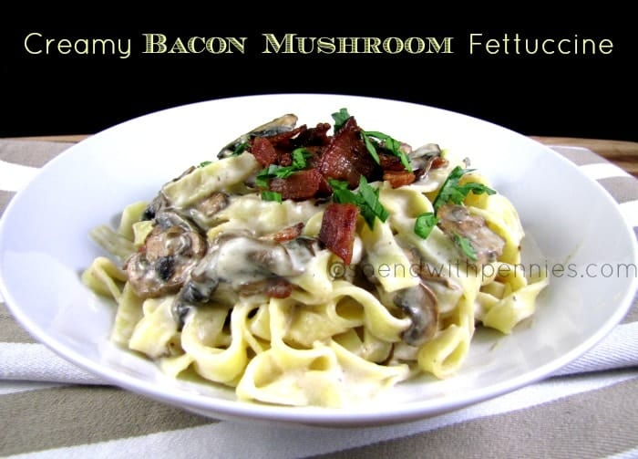 creamy bacon mushroom fettuccine in a white bowl
