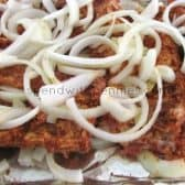 prepping BBQ ribs for the oven with onions