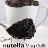 closeup of a spoonful of nutella mug cake with the mug in the background