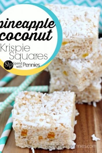 pineapple coconut krispie squares on a wood board