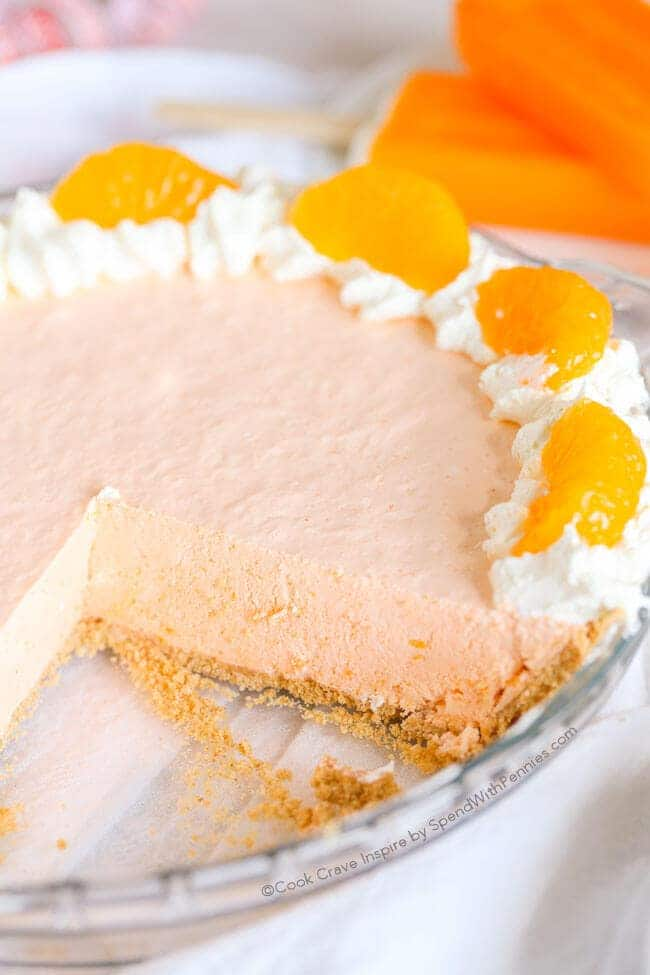 Whole Creamsicle Pie with a slice removed