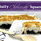a slice of fluffly cheesecake squares with blueberry filling on the bottom, on a plate with the whole cheesecake in the background
