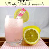 Spiked Frosty Pink Lemonade with a lemon garnish