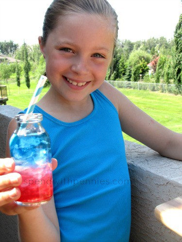 girl holding a layered red, white and blue drink