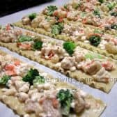 Broccoli Chicken Roll-Ups laid out before rolling
