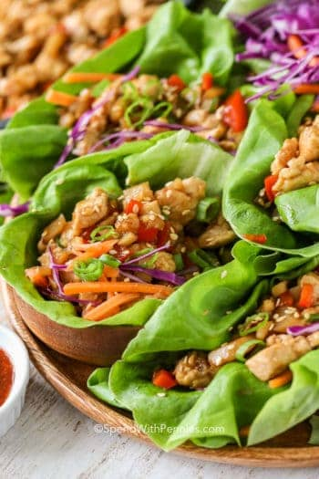 Chicken Lettuce Wraps on a wooden plate