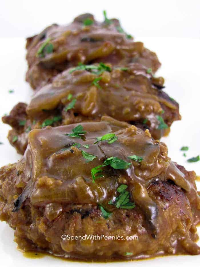 Three Salisbury Steak patties with mushroom gravy and parsley