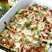 Stuffed Zucchini Boats in dish with parsley