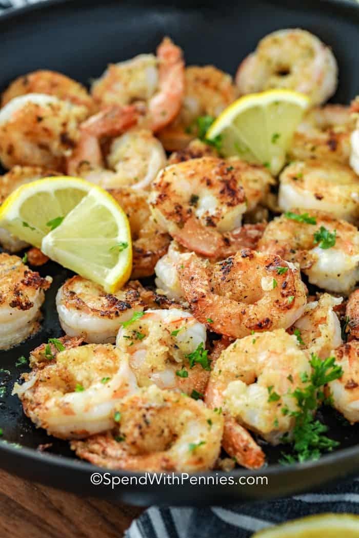 Lemon pepper shrimp cooked in a frying pan.