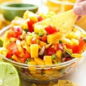mango salsa in glass bowl with chip