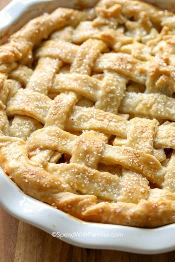 Apple pie in a white dish with lattice crust