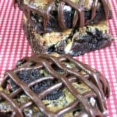 chewy Oreo brownie with chocolate frosting drizzled on top