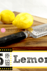 lemons on a wood board with a zester and a little zest