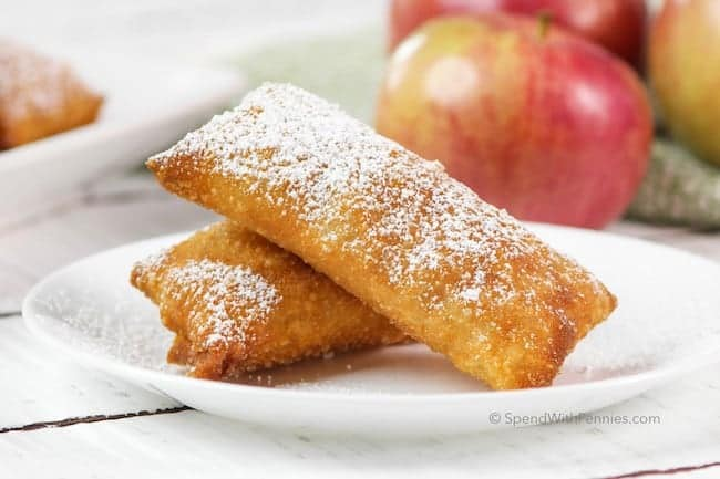 two apple pie egg rolls on a plate